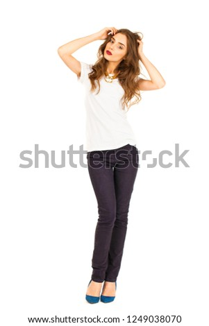 bb06b4a454 Full-length portrait of beautiful girl in jeans and white t-shirt   1249038070