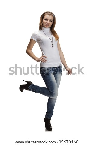 Full-length portrait of beautiful girl in jeans and white t-shirt