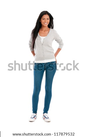 Full length portrait of beautiful young hispanic woman smiling isolated on white background