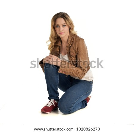 ea8728587 Portrait of pretty woman on white background wearing leather pants ...