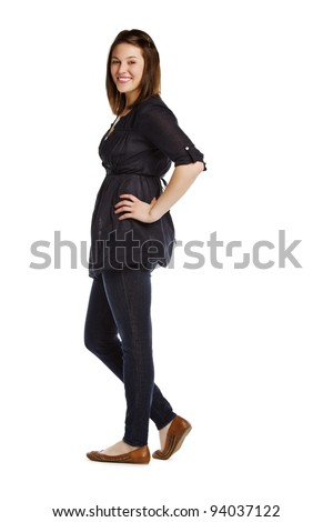 Full length portrait of brunette standing on white background with hand on hip