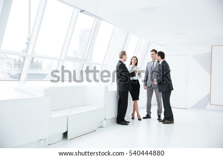 Full length portrait of Business team stand near the window in conference room Stockfoto ©