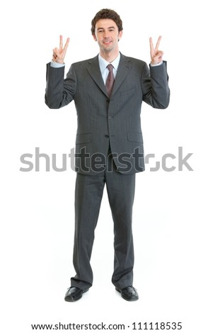 Full length portrait of businessman showing peace gesture