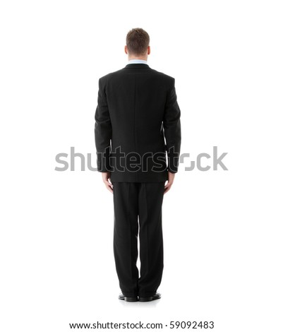 Full length portrait of businessman standing back, isolated