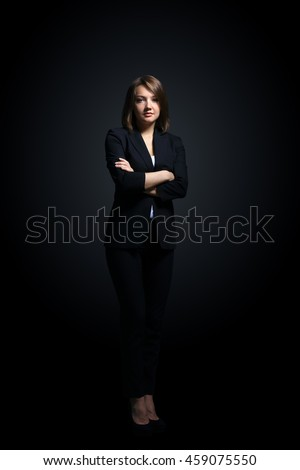 Full-length portrait of businesswoman  isolated on black background #459075550