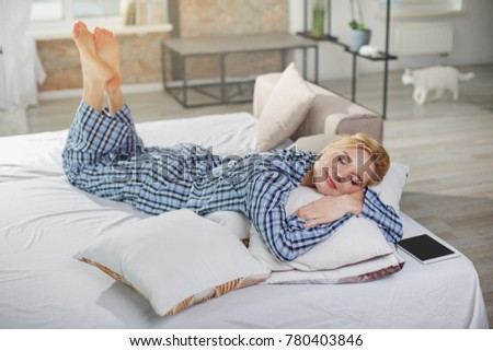 Full length portrait of calm girl napping in comfortable bed