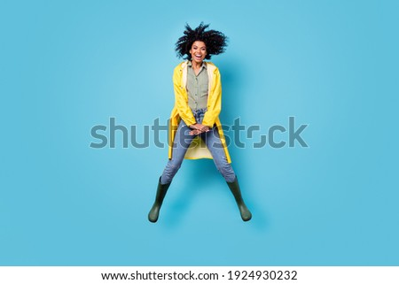 Full length portrait of carefree cheerful dark skin person good mood toothy smile isolated on blue color background Foto stock ©