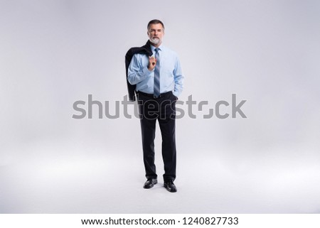 Full length portrait of confident mature businessman in formals standing isolated over white background #1240827733