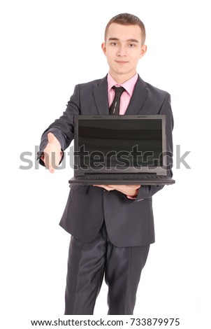 Full length portrait of confident mature businessman with a laptop in formals standing isolated over white background #733879975