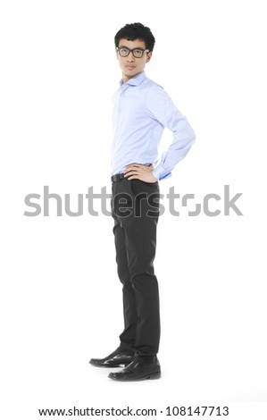 Full length portrait of confident young businessman standing