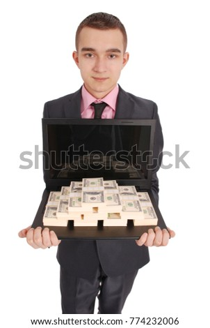 Full length portrait of confident young businessman which keeps the laptop and money in formals standing isolated over white background #774232006