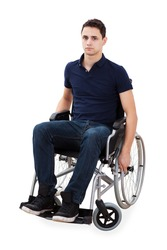 Full length portrait of confident young man sitting in wheelchair isolated over white background