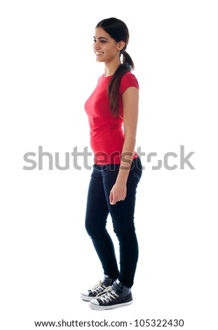 Full length portrait of confident young teenager against white background