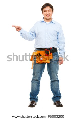 Full length portrait of construction worker pointing on side