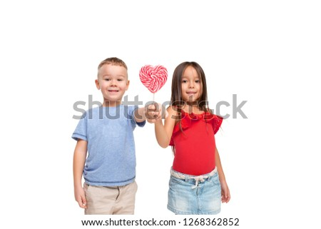 2115a4247 Full length portrait of cute little kids girl and boy in stylish clothes  looking at camera