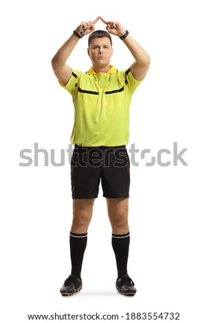 Full length portrait of football referee gesturing a VAR symbol isolated on white background Imagine de stoc ©