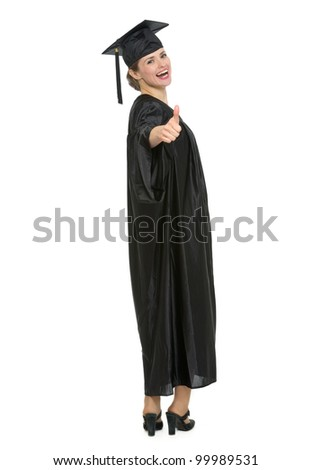 Full length portrait of graduation student woman showing thumbs up. HQ photo. Not oversharpened. Not oversaturated