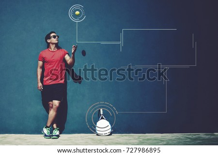 Full length portrait of handsome sportsman tossing a paddle ball standing against wall with copy space area for your text message or advertising content. Infographics elements - Shutterstock ID 727986895