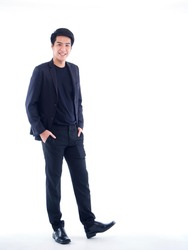 Full length portrait of handsome young man posing on white background