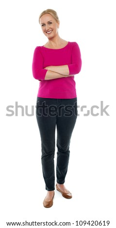 Full length portrait of happy aged woman posing with arms crossed isolated on white background