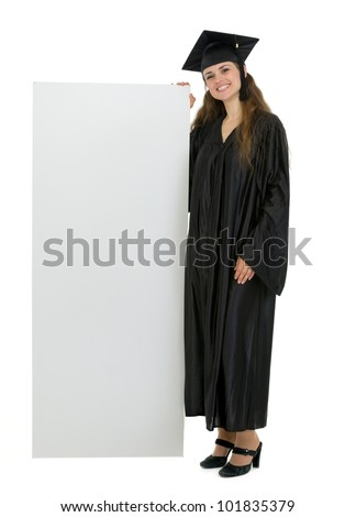 Full length portrait of happy graduation student holding blank billboard
