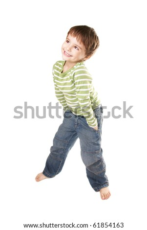 Full length portrait of happy smiling little boy in jeans on white background