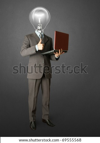 Full length portrait of lamp-head businessman with laptop, showing welldone