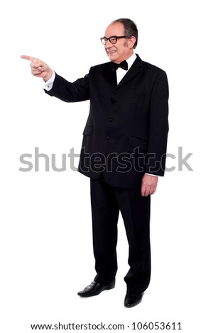 Full length portrait of male pointing at copy space