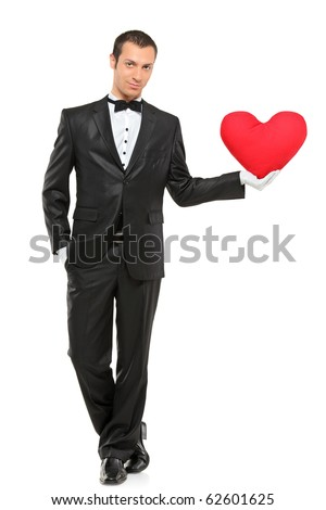 Full length portrait of man holding a red heart-shaped pillow isolated against white background