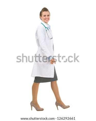 Full length portrait of medical doctor woman going sideways