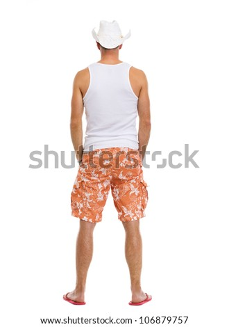 Full length portrait of on vacation man in shorts. Rear view