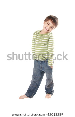 Full length portrait of pretty smiling little boy in jeans on white background