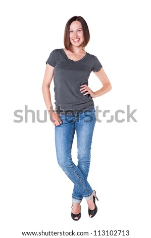 full-length portrait of smiley and happy woman in grey t-shirt and blue jeans. isolated on white background