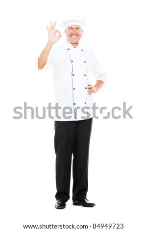 full length portrait of smiley cook showing ok sign. isolated on white background