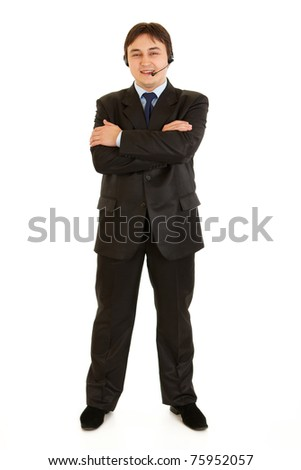 Full length portrait of smiling businessman with headset and crossed arms on chest isolated on white