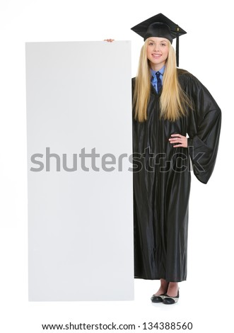 Full Length Portrait Of Smiling Young Woman In Graduation Gown ...