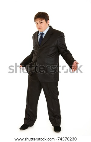 Full length portrait of surprised businessman turning his empty pocket inside out isolated on white. Concept - bankruptcy