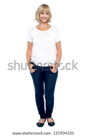 Full length portrait of trendy middle aged woman dressed in fashion casuals.