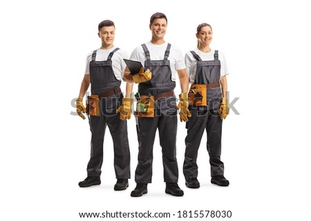 Full length portrait of two male and one female workers with a tool belts isolated on white background Stock photo ©