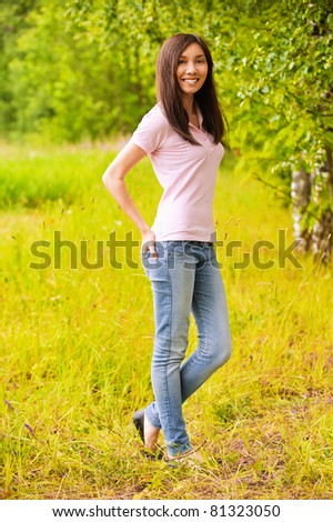 Full-length portrait of young beautiful smiling casually clothed woman