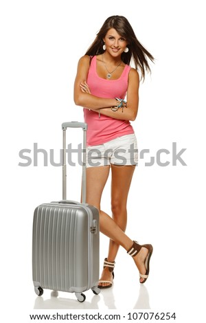 Full length portrait of young female standing with suitcase going on holidays isolated on white background