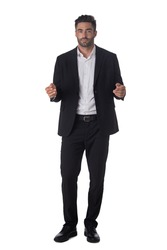 Full length portrait of young handsome business man in black suit holding something in hands studio isolated on white background