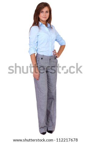 Full length portrait of young happy smiling attractive businesswoman in blue shirt, isolated on white