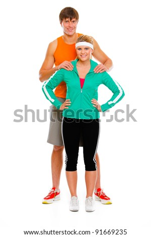 Full length portrait of young man and healthy girl in sportswear isolated on white