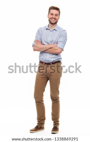 Full length portrait of young man standing on white background Stock foto ©