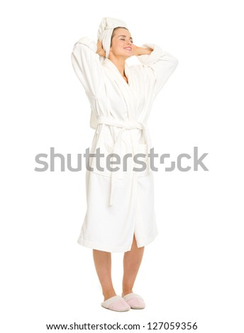 Full length portrait of young woman in bathrobe enjoying freshness