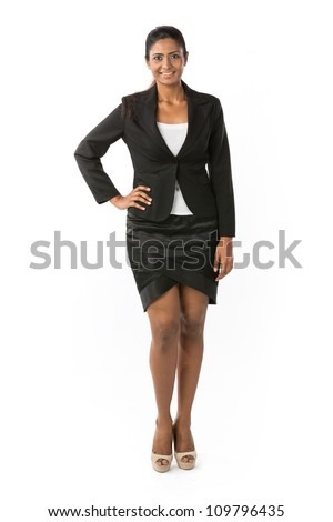 Full length Portrait Portrait of a happy Indian business woman. Isolated on a white background.