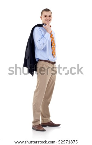 Full length profile of a young business man with coat over shoulder against white