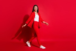 Full length profile photo of beautiful business successful lady walk conference seminar meeting wear luxury office blazer trousers suit white shirt footwear isolated red color background