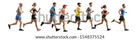 Full length profile shot men and women running a marathon isolated on white background Stock fotó ©